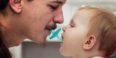Sucking on your kid's pacifier