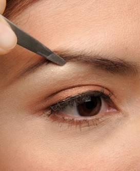 Eyebrow tweezing